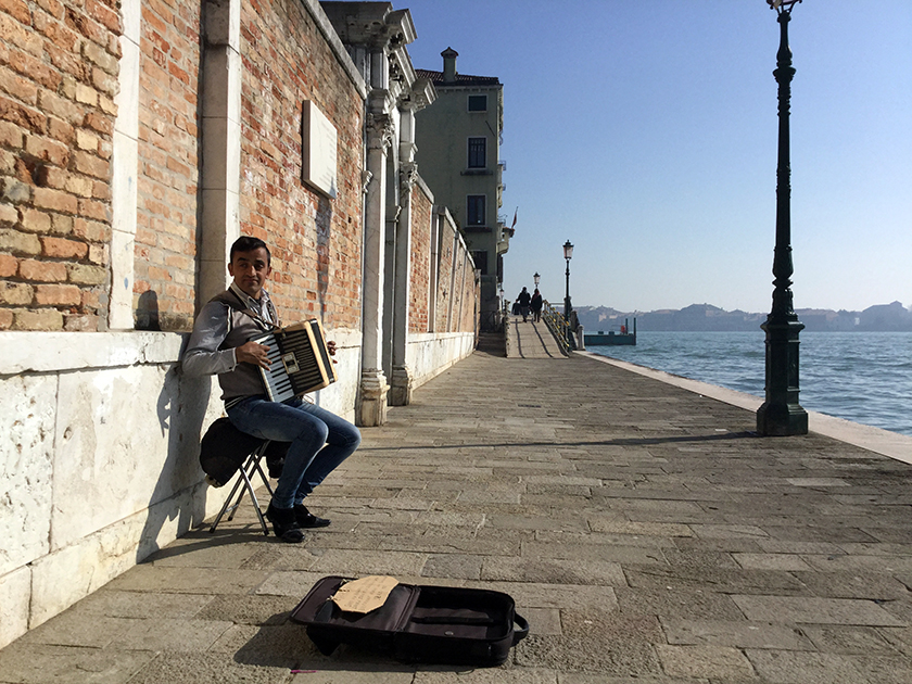 The man and the wall. I encountered this street musician during my recent visit to Venice, Italy in February 2017.